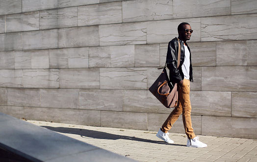 Fashion stylish young african man in city