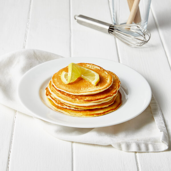 stack of pancakes with lemon on top