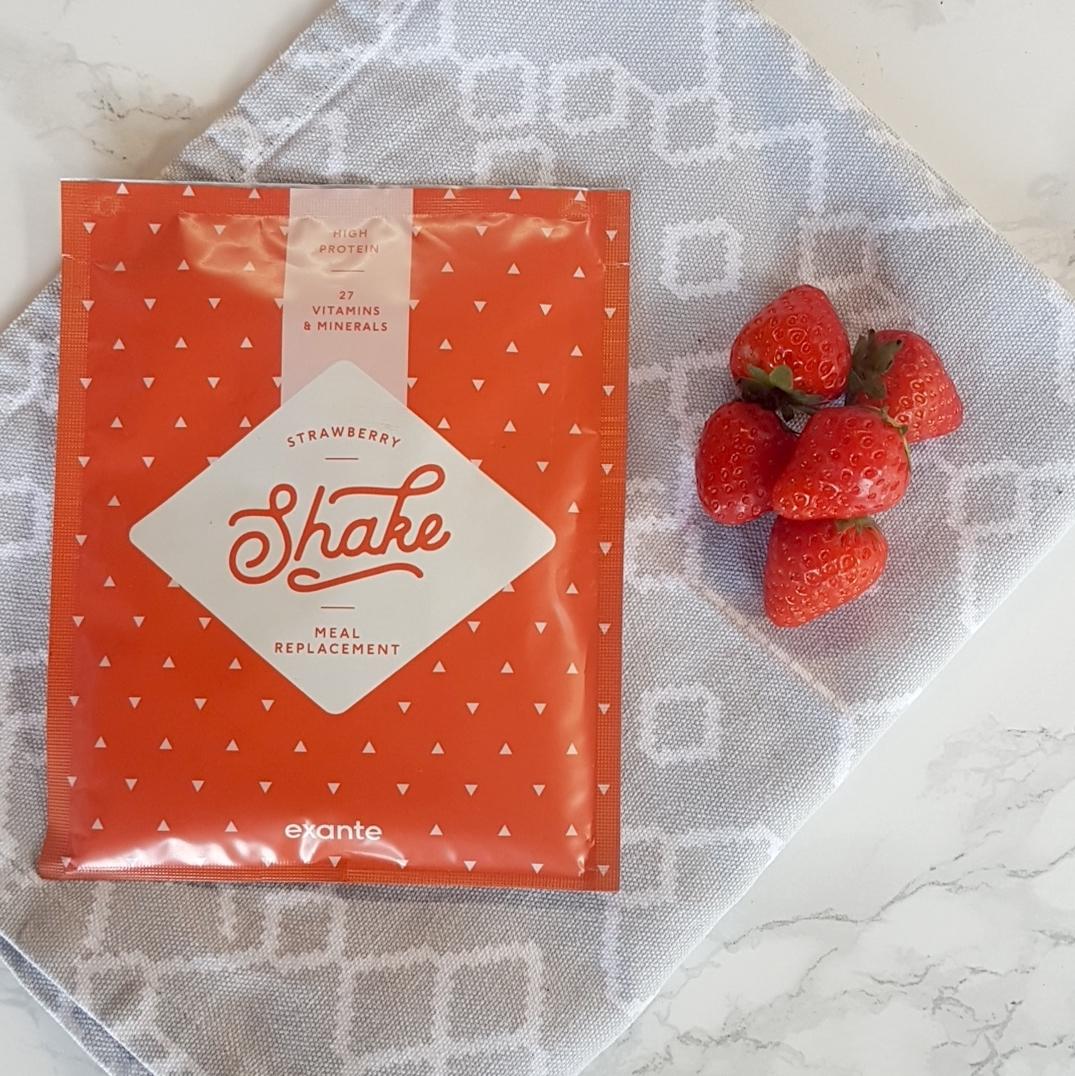 strawberry shake on teatowel next to strawberries