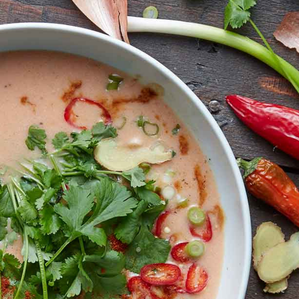 red thai chicken soup seasoned with chilli and coriander