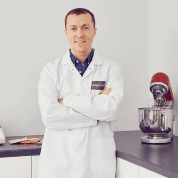 image of our nutritionist in white medical coat