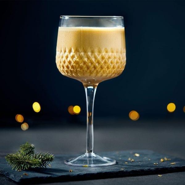 gingerbread shake in wine style glass on black slate