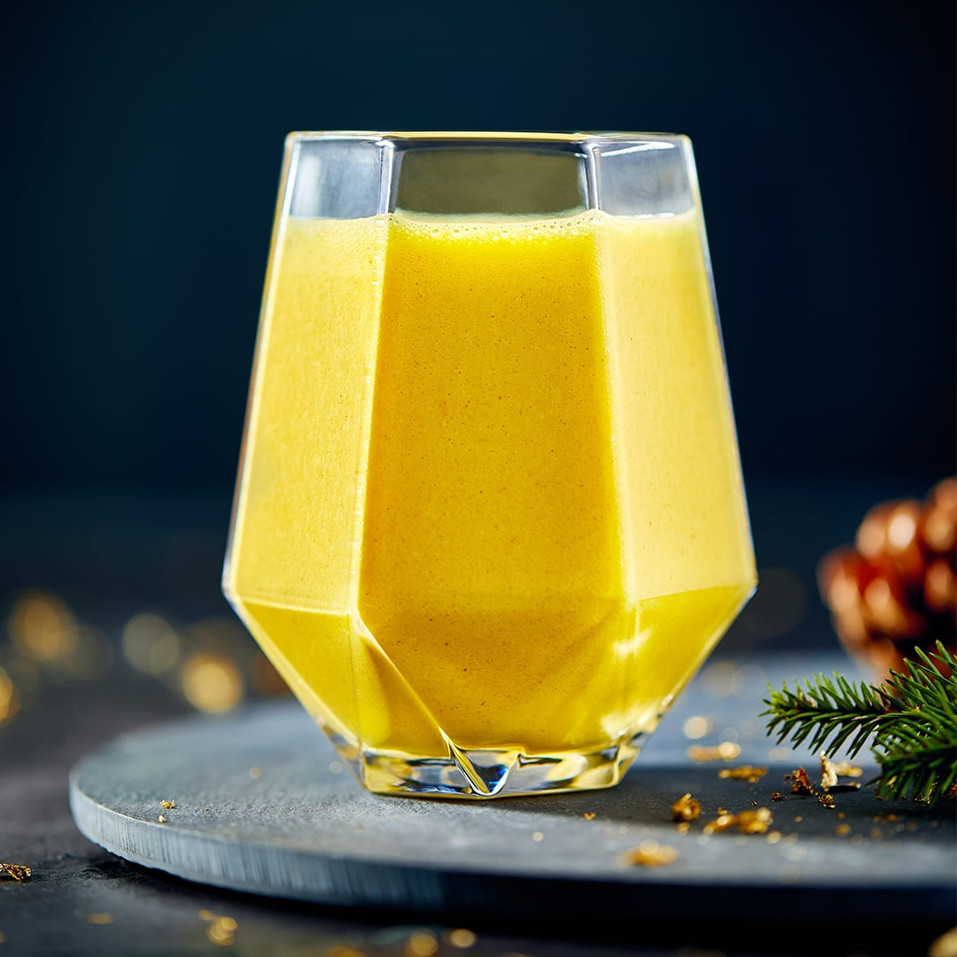 spiced orange shake in glass on slate board