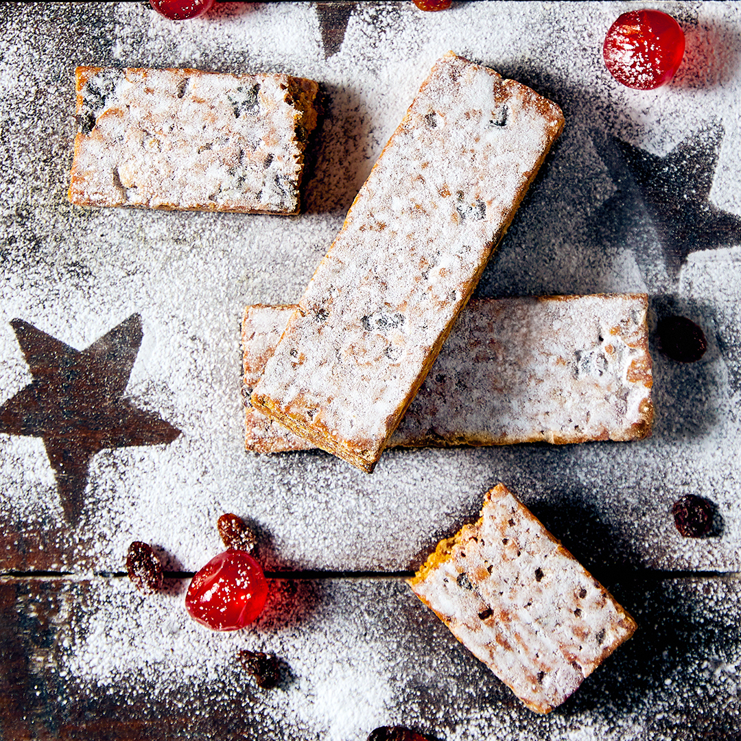 Stollen bar chopped up and sprinkled with icing sugar