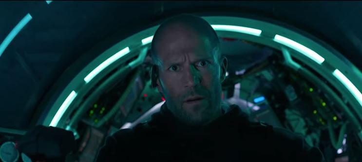 "Jason Statham smouldering after saying ""it's a megalodon"" in our The Meg review"
