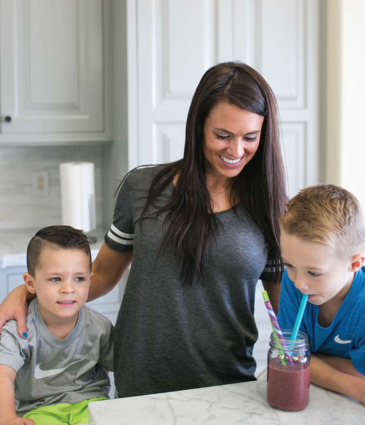 nicole in kitchen w/ kids