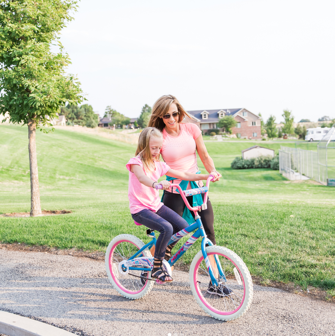 lisa helping daughter ride a bike