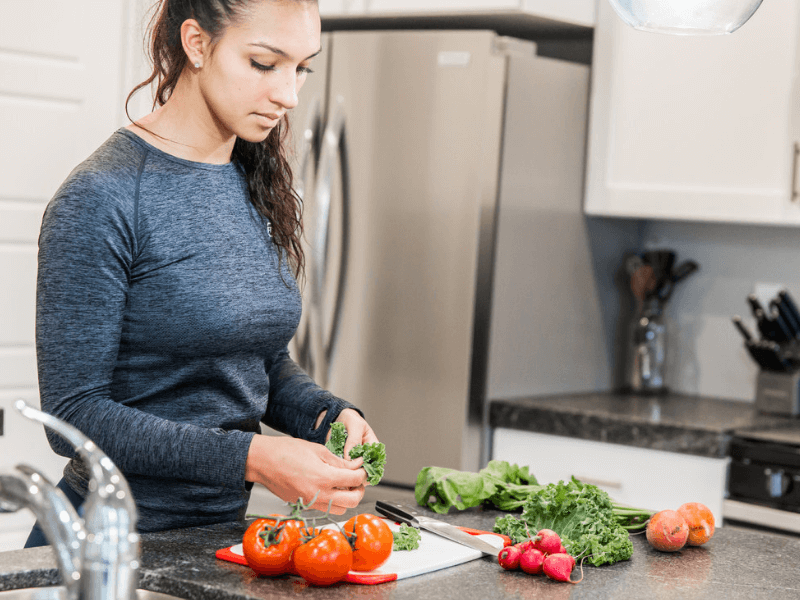 A woman slicing vegetables