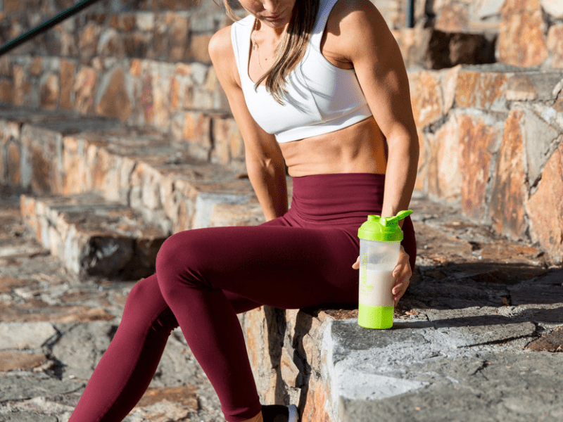 A woman drinking vegan protein