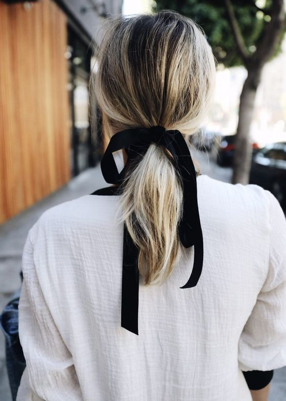 Woman with black ribbon ponytail