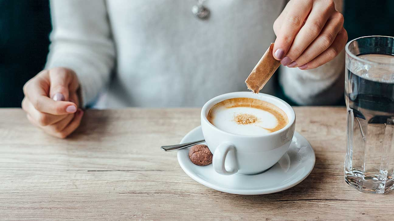 Artifical sweeteners being added to coffee