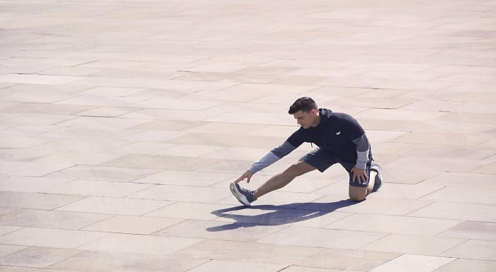 atleta_alongamento_pernas