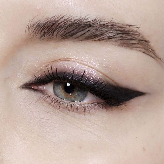 New Year's eve makeup eye look graphic dramatic eyeliner