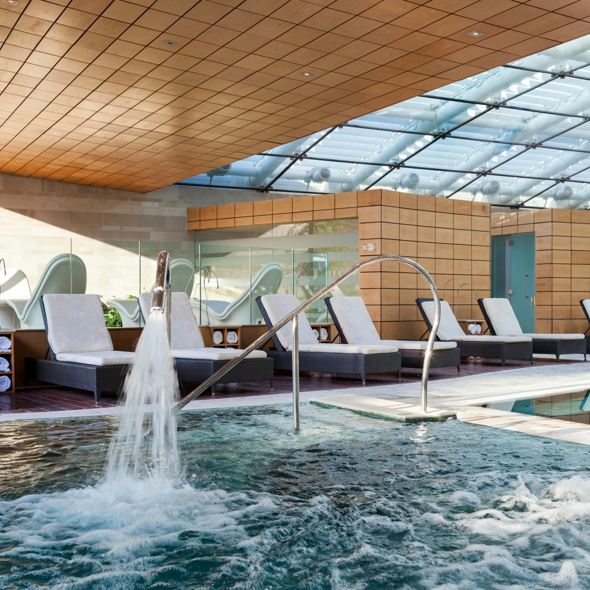 Indoor spa pool with jets and beds to lie on