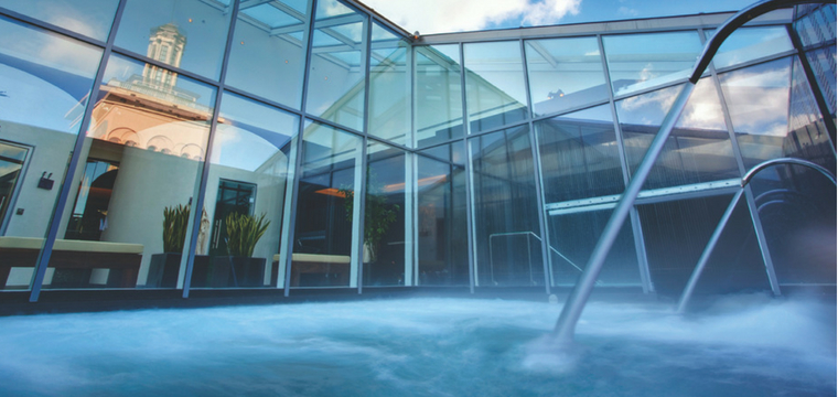 Outside pool beside a glass building