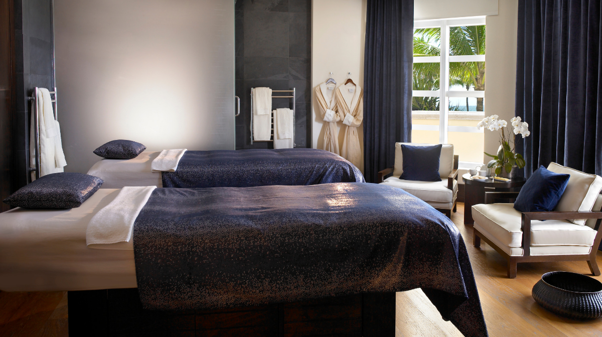 spa beds and dressing gowns in spa treatment room
