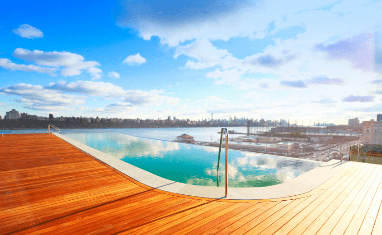 Infinity pool overlooking New York City in the sun