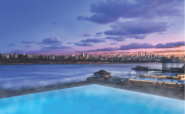 Pool overlooking New York City at sunset