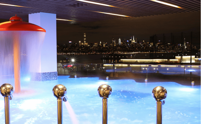 Hydrotherapy pool with jets overlooking New York City at night