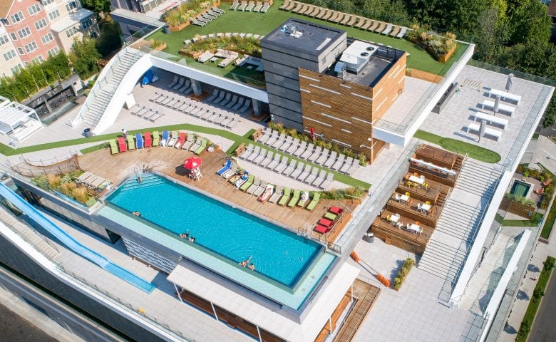 Rooftop of SoJo spa with infinity pool and sun loungers