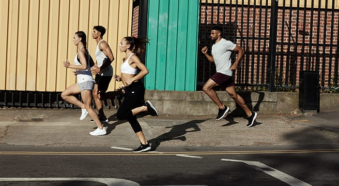 young men and women running