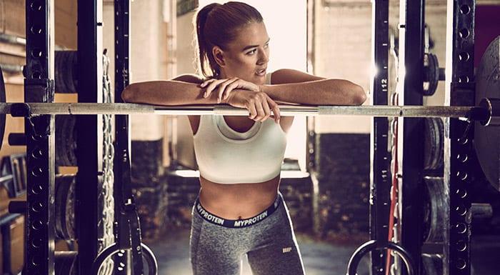female athletes with squat rack