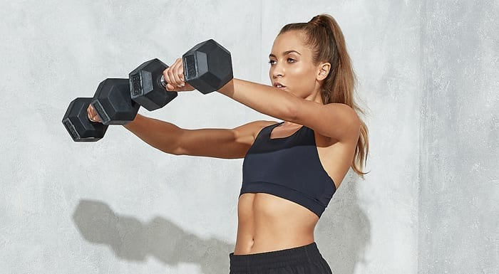 female holding dumbbells