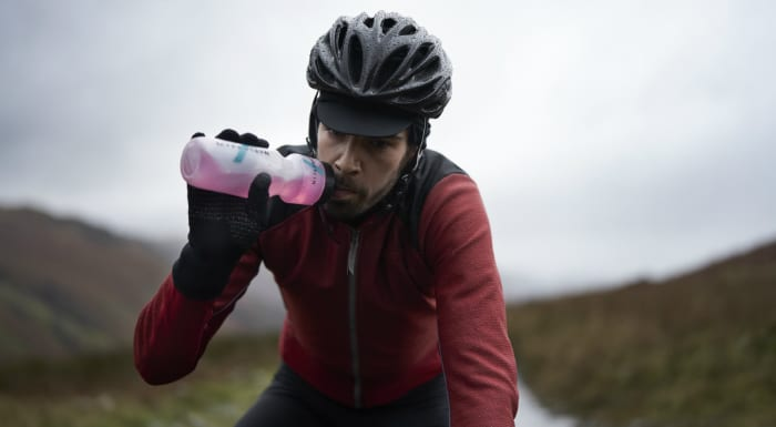 cyclist drinking supplement