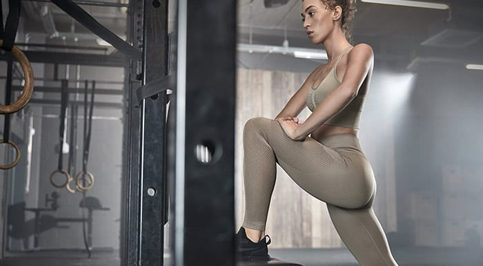 woman stretching in the gym