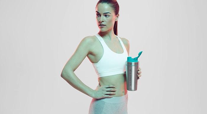 woman drinking essential amino acids