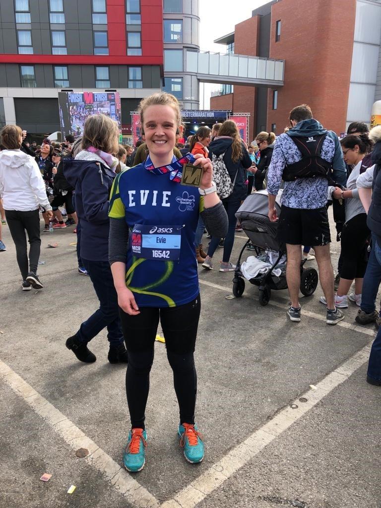 girl with marathon medal
