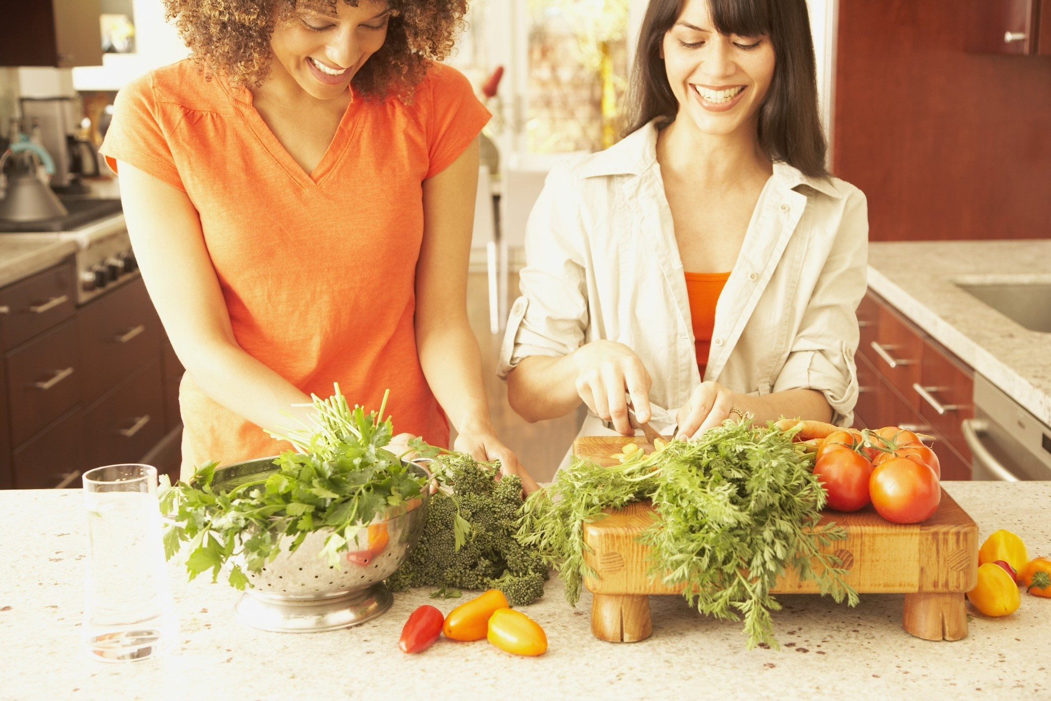 friends chopping vegetables