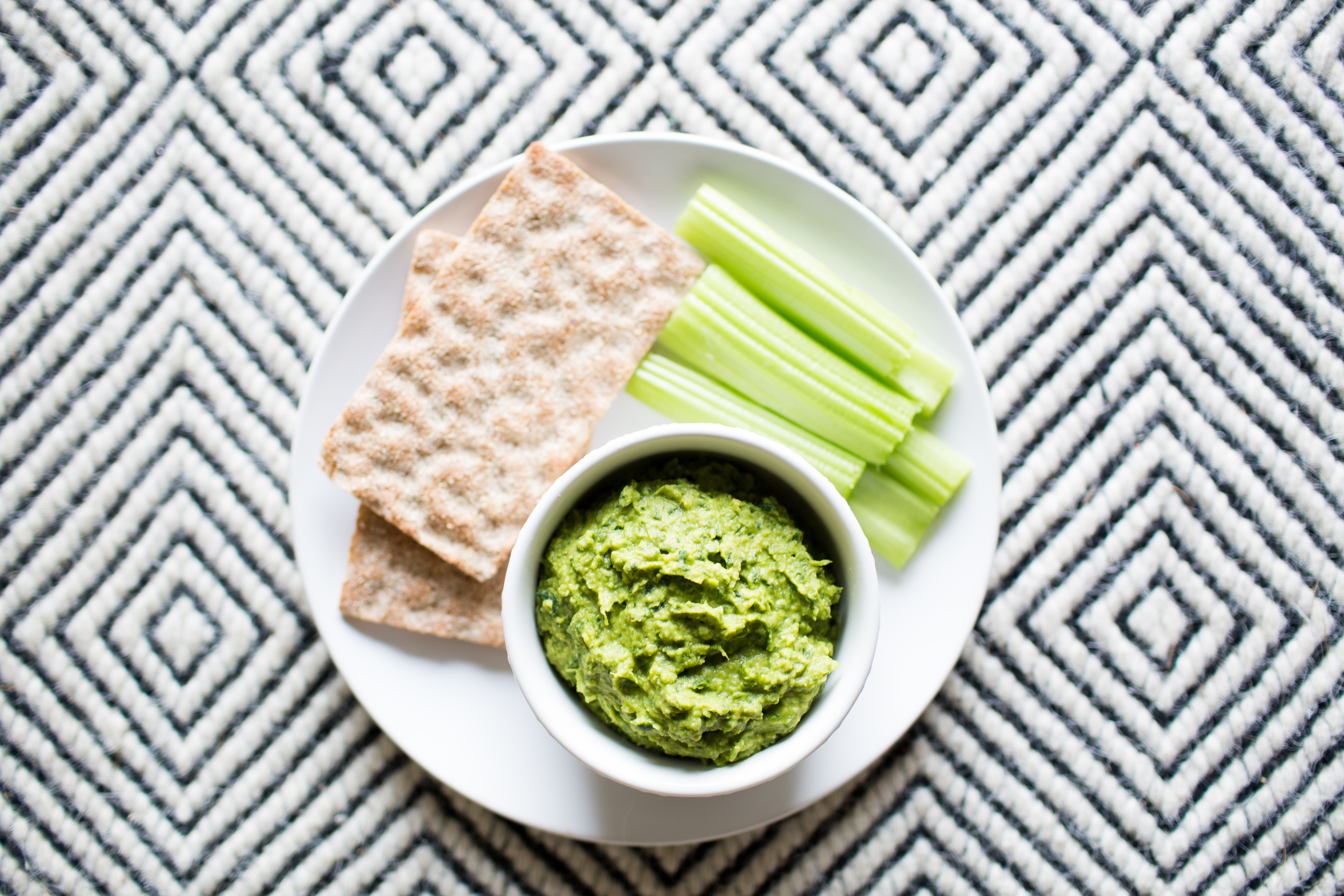 Green Herb Hummus with Celery Sticks and Crackers