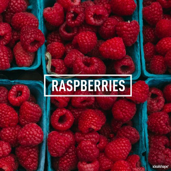 Cartons full of ripe raspberries