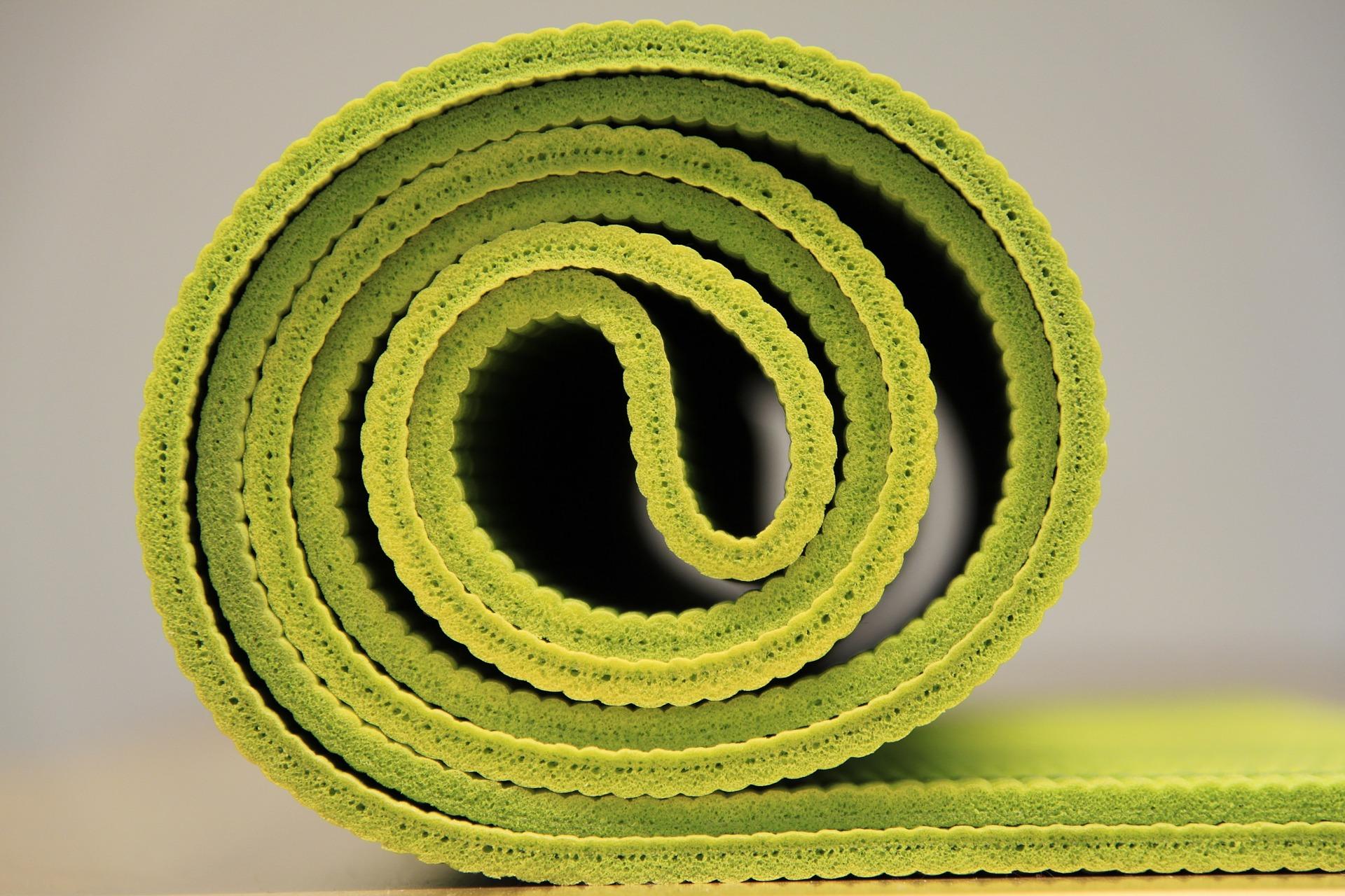 green rolled yoga mat