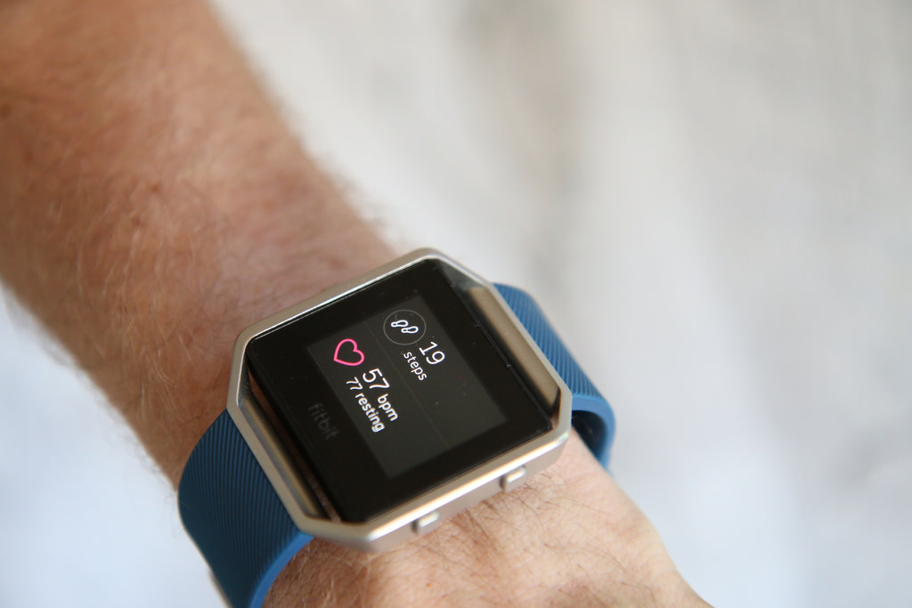 blue FitBit fitness and activity tracker