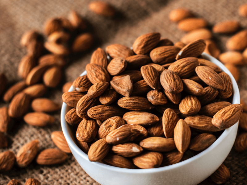 A bowl of almonds, which contain magnesium