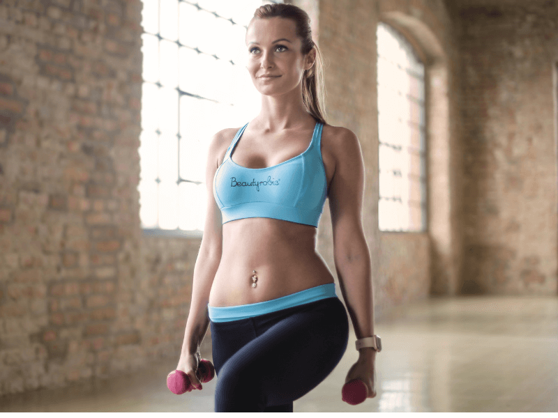 A woman doing lunges in a gym