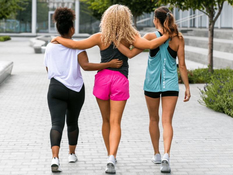 A group of women walking to the gym