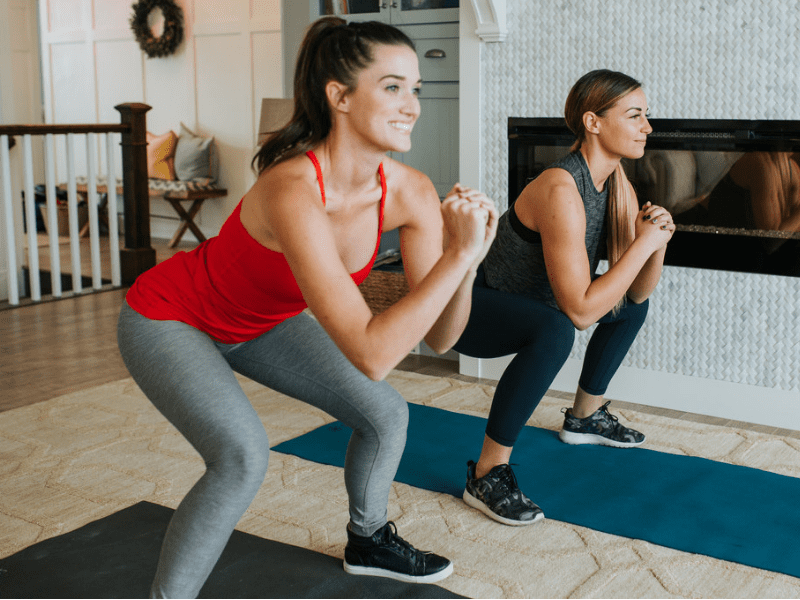 Two women doing an at-home workout together