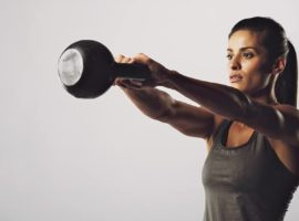 woman performing kettle bell exercise