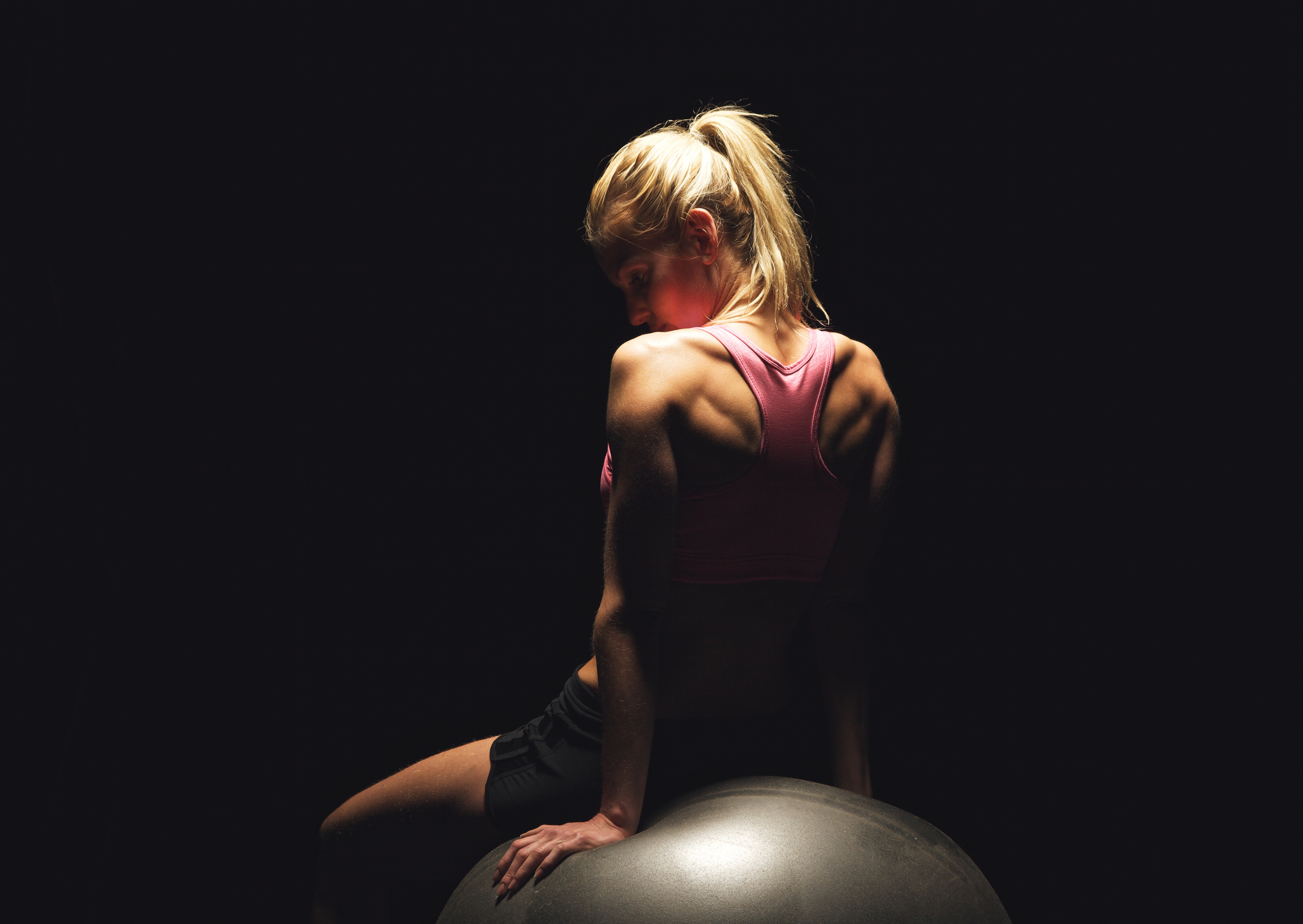woman sitting on a pilates ball