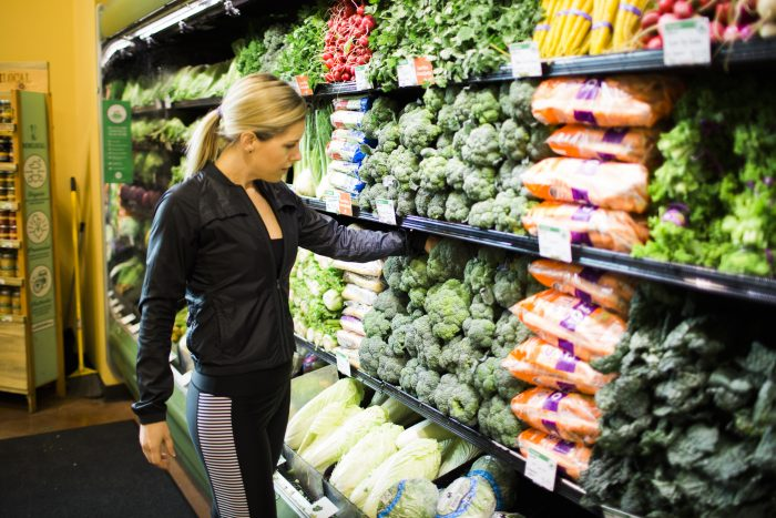 Lindsey grocery shopping for fresh produce