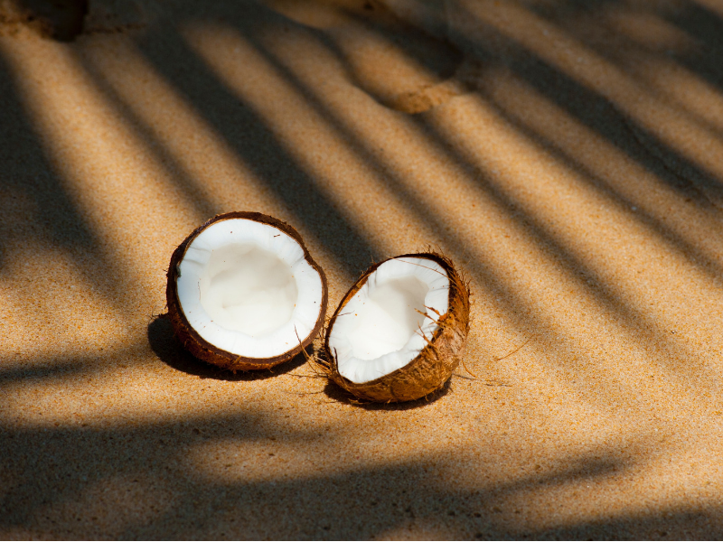 A split coconut on the beach