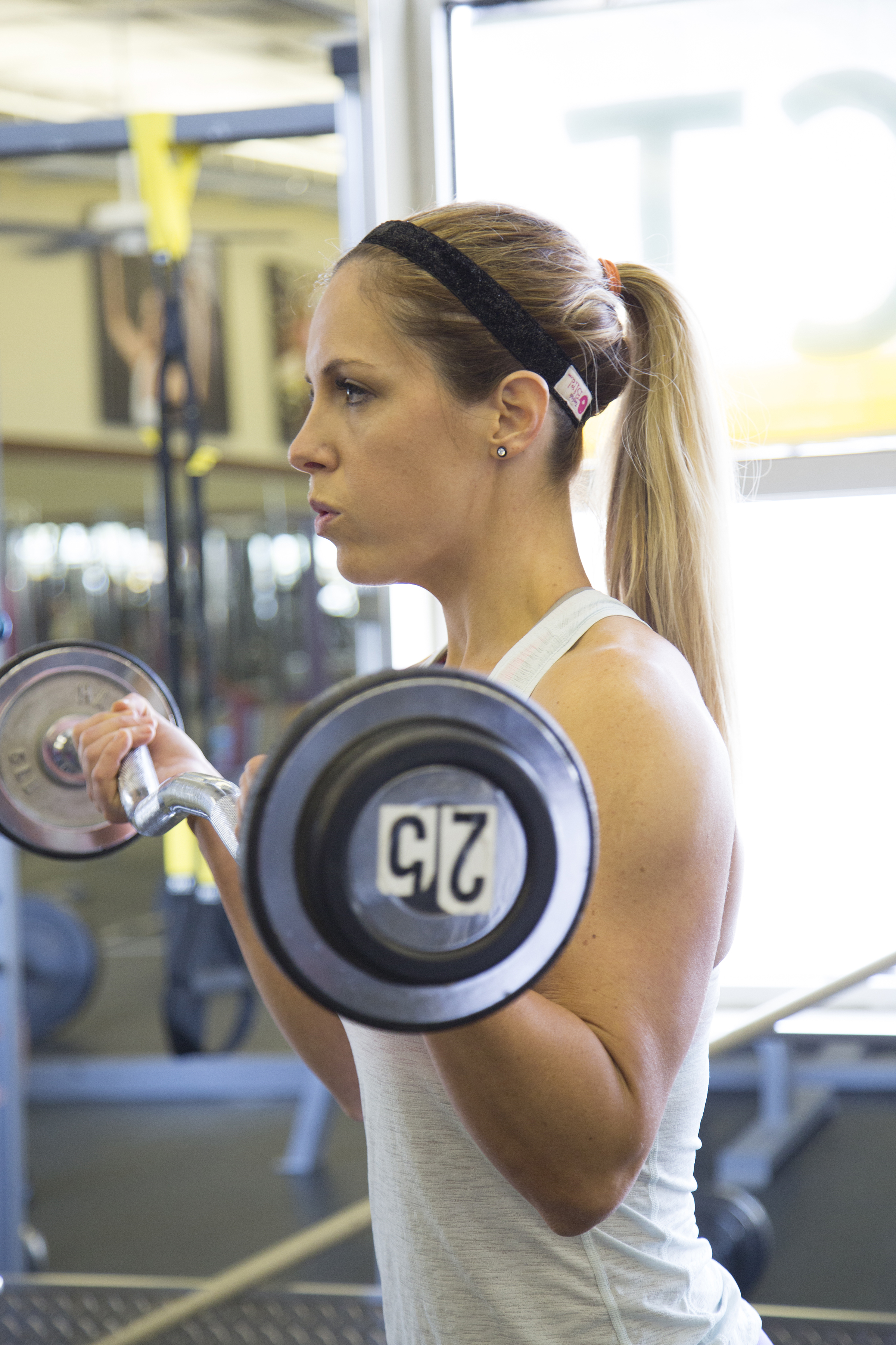 Lindsey performing barbell curl