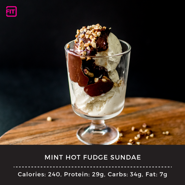 a mini hot fudge sundae in a clear bowl