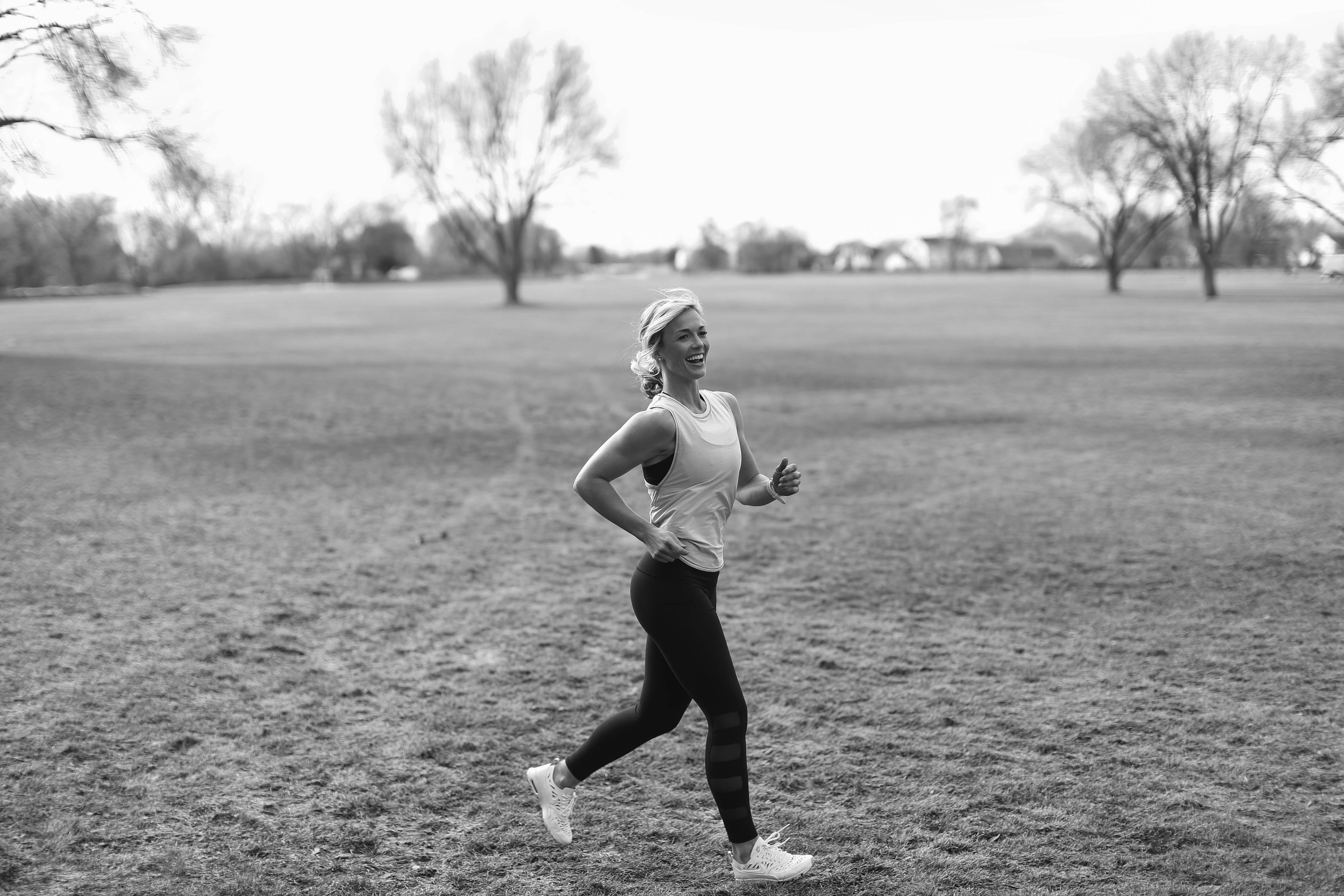Coach Kristi running outside