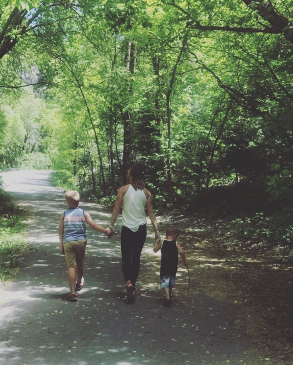 tamara on a walk with sons