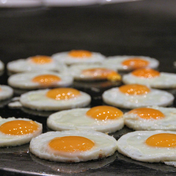 A griddle filled with fried eggs