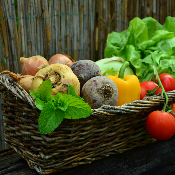 A basket full of colorful vegetables